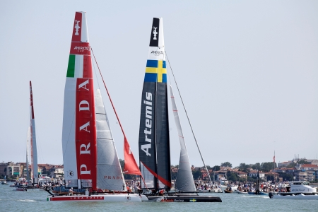 Venice, Italy: the catamarans of Artemis Team, Swedish, and Luna Rossa Prada Team, Italy are engaged in the race during the 34th America's Cup, World series, on May 19 in Venice, Italy Stock Photo - 13824707