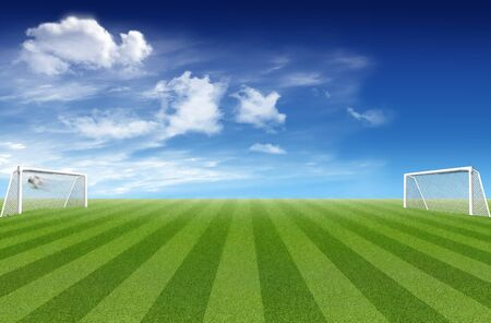 Soccer field with ports and football and cloudy sky in the background