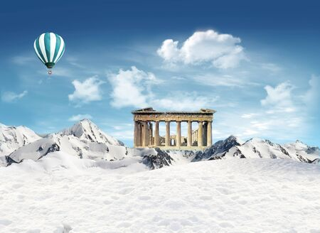 Parthenon, greek landmark, among the mountains with snow and hot air balloon flying in the sky photo