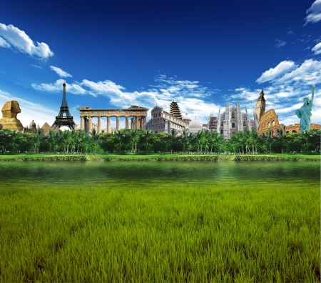 Grassland with llagoon and palm trees with world landmarks in the background Stock Photo