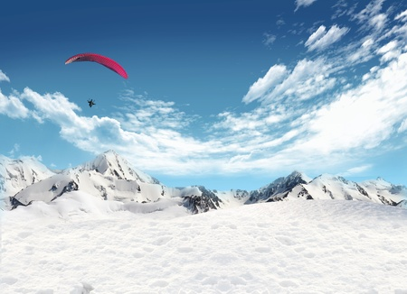 Snowfield and mountain landscape with man flying in the sky