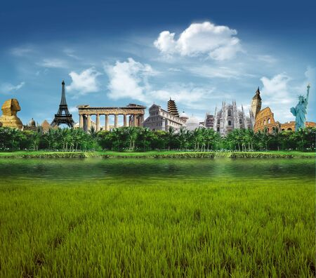 Grassland with llagoon and palm trees with world landmarks in the background Imagens