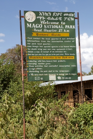 headquarter: Mago National Park, Ethiopia, February 15, 2013: indication panel and visitor guide of the Mago National Park Headquarter Editorial