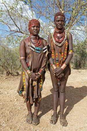 body paint: Kolcho, Ethiopia, February 16, 2013: african tribal women of thge Banna ethnic group, are wearing tribal clothes and necklaces and have tribal body paint and hairstyle  Editorial