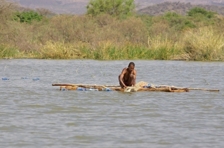 Arba Minch, Ethiopia, February 21, 2013: african fisherman with traditional boat is  fishing on the lake Chamo.