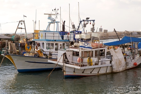 Traditional fishermen boats with israeli flag at the Jaffa harbour, Jaffa town, Israel, photo