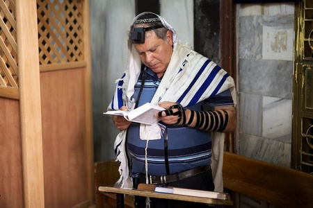 Jewish man are praying in the synagogue in Hebron, Israel