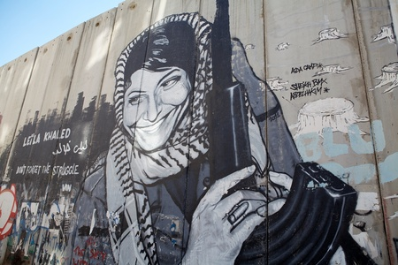 barrie: Leila Khaled graffiti on the Israeli West Bank barrier near Bethlehem  The israeli West bank barrier is a security and separation barrier between the State of Israel and the West Bank  Israel argues that the barrier is necessary tomprotect israeli civilia
