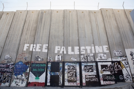 palestinian: Graffiti on the Israeli West Bank barrier in Bethlehem  The israeli West bank barrier is a security and separation barrier between the State of Israel and the West Bank  Israel argues that the barrier is necessary tomprotect israeli civilians from palesti
