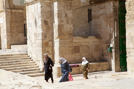 Arab women with traditional dress are going to the Temple Mount, Jerusalem, Israel
