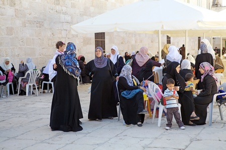 Arab women with traditional clothes and her children are visiting the Temple Mount, Jerusalem, Israel