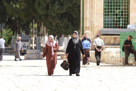 Arab women with traditional clothes are going to the mosque at the Temple Mount, Jerusalem, Israel