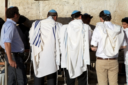 jewish town: Jewish men are praying at the Western Wall at the Jerusalem old town, Jerusalem, Israel