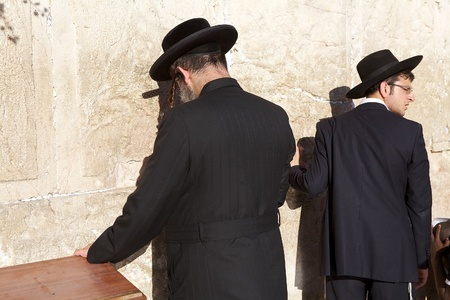 jewish town: Jewish orthodox man are praying at the Western Wall in the Jerusalem old town, Jerusalem, Israel