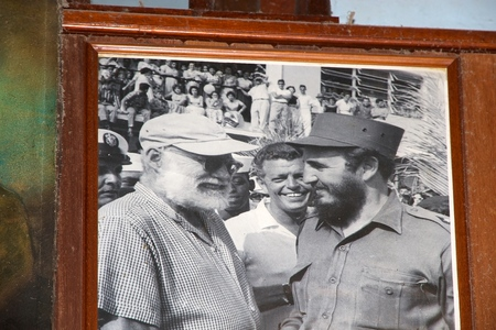 ernest: Ernest Hmingway met Fidel Castro in the old photo on the wall at the La Bodeguita del Medio at the Old Havana, Cuba   Editorial