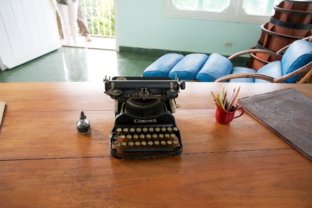 hemingway: The typewriter on the desk of Hernest Hamingway in the tower of the Finca Vigia   Finca Vigia was the home of Hernest Hemingway in the suburb of the Havana, Cuba  Now the Finca Vigia is a museum Editorial