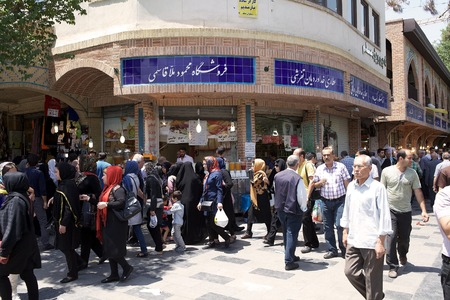 Iranian people are walking at the bazaar, the old traditional market, along the streets in Tehran, Iran