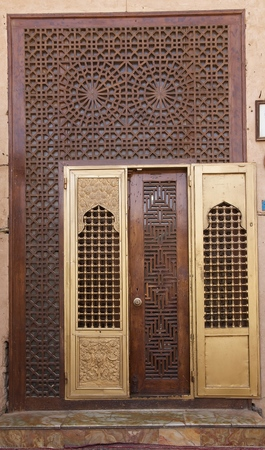 notable: Architecture details of one door at the Boghen Seyed Roknaddin mausoleum where there is the tomb of the local islamic notable Seyed Roknaddin, Yazd, Iran