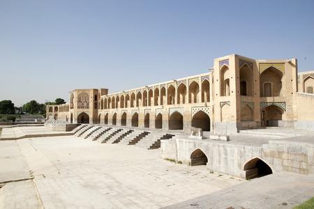 safavid: Khaju Bridge at Isfahan, Iran  Khaju Bridge was built by the persian Safavid King Shah Abbas II around 1650, serving as both a bridge and a dam across the Zayandeh river, now dry in town  Khaju Bridge has 24 arches and is 133 metres long and 12 metres wid