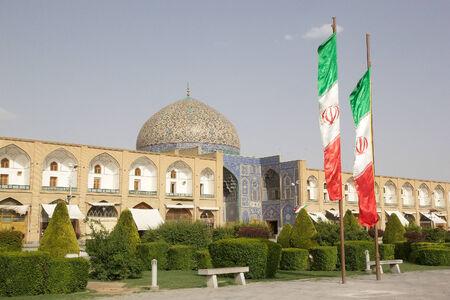 sheik: Iranian flags and Sheik Lotfollah Mosque at the Naqsh-e Jahan square, Isfahan, Iran.