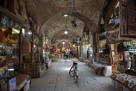 Tourists at the bazaar of Isfahan, Iran. The bazaar is a historical market, one of the largest bazaars in the Middle East, dating back to the 17th century. The bazaar is vaulted two kilometer street linking the old city to the new. Editorial