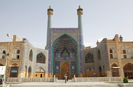 worl: The entrance iwan with its towering facade of the Shah Mosque also known as Imam Mosque. The mosque  standing at the South side of the Naqsh-e Jahan square, Isfahan, Iran. Built during the Safavid period, the costraction began in 1611. It is a Unesco Worl Editorial