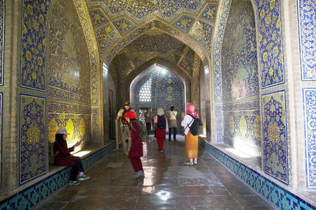safavid: Tourists are visiting the interior of the dome of the Sheik Lotfollah Mosque at the Naqsh-e Jahan square, Isfahan, Iran. The mosque is one of the architectural masterpieces of Safavid iranian architecture. The costraction started in 1603 and was finished