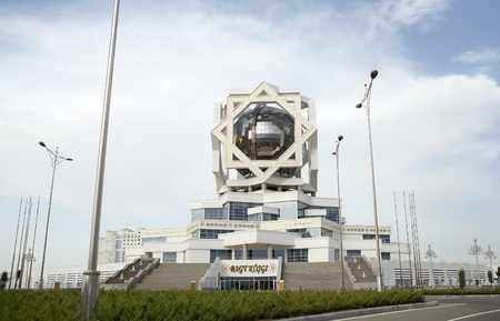 building monumental: Wedding Palace at Ashgabat, Turkmenistan.  After the existing the Soviet Union, the city has adopted modern construction techniques. The Wedding Palace is a monumental building, the five floors of which have been built in the shape of a Turkmen star upon