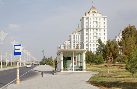 Bus stop along the street in Ashgabat, Turkmenistan. Ashgabat is the capital of Turkmenistan. After the existing the Soviet Union, the city has adopted modern construction techniques. More than 60 bus lines cover a total range of 2200 km with 700 buses ru