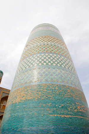 Kalta minor Minaret, the  Short Minaret at the Itchan Kala, Khiva, Uzbekistan. Itchan Kala is the walled inner town of the city of Khiva. Since 1990 it has been protected as a World Heritage Site. The Kalta minor Minaret has become the real symbol of  Stock Photo