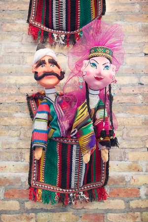 artisanal: Traditional uzbek marionettes dressed in national costumes for sale in the artisanal shop in the historic centre of Bukhara, Uzbekistan. As a rule, puppets represent folk types, literary characters.