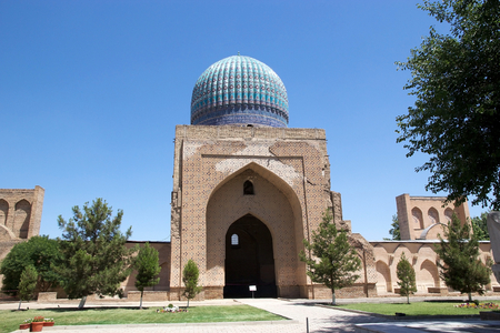 entranceway: The cupola of the main chamber at the Bibi Khanym Mosque, Samarkand, Uzbekistan. The mosque is a famous historical Friday mosque in Samarkand, whose name comes from the wife of Amir Timur. The cupola reaches a height of 40 meters and the entranceway is 35 Stock Photo