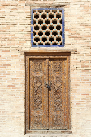 conqueror: Finely carved wooden door at the Amir Temur Mausoleum, Samarkand, Uzbekistan. It is the mausoleum of the asian conqueror Tamerlane, aolso known as Timur. It is important in the history of Turkic-Persian Architecture as the precursor and model for later gr Editorial