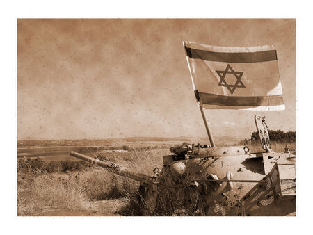 israel war: A vintage image of old tank used during the 1967 war with the flag of Israel on the Golan, Israel Stock Photo