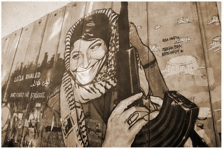west bank: Leila Khaled graffiti on the Israeli West Bank barrier near Bethlehem