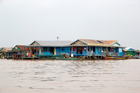 sap: Traditional floating village on the Tonle Sap lake, Cambodia. Tonle Sap is a combined lake and river system of major Importance to Cambodia and it is the largest freshwater lake in the Southeast Asia Editorial