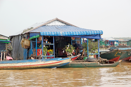 tonle sap: Traditional floating house on the Tonle Sap lake, Cambodia. Tonle Sap is a combined lake and river system of major Importance to Cambodia and it is the largest freshwater lake in the Southeast Asia Editorial