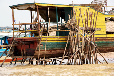Traditional boat on the Tonle Sap lake, Cambodia. Tonle Sap is a combined lake and river system of major Importance to Cambodia and it is the largest freshwater lake in the Southeast Asia photo