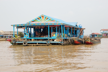 tonle sap: Traditional floating retail shop in the floating village on the Tonle Sap lake, Cambodia. Tonle Sap is a combined lake and river system of major importance to Cambodia and it is the largest freshwater lake in the Southeast Asia