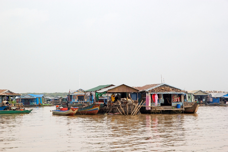 Traditional floating village on the Tonle Sap lake, Cambodia. Tonle Sap is a combined lake and river system of major importance to Cambodia and it is the largest freshwater lake in the Southeast Asia