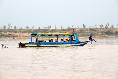 tonle sap: Traditional boat on the Tonle Sap lake, Cambodia. Tonle Sap is a combined lake and river system of major importance to Cambodia and it is the largest freshwater lake in the Southeast Asia
