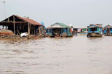 tonle sap: Traditional floating village on the Tonle Sap lake, Cambodia. Tonle Sap is a combined lake and river system of major importance to Cambodia and it is the largest freshwater lake in the Southeast Asia Editorial