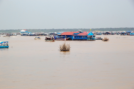 Traditional floating village with the floating church on the Tonle Sap lake, Cambodia. Tonle Sap is a combined lake and river system of major importance to Cambodia and it is the largest freshwater lake in the Southeast Asia