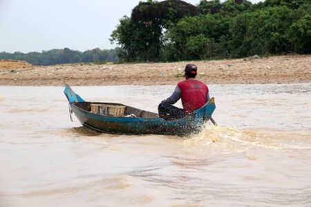 tonle sap: Inhabitant  on the Tonle Sap lake, Cambodia. Tonle Sap is a combined lake and river system of major importance to Cambodia and it is the largest freshwater lake in the Southeast Asia Editorial