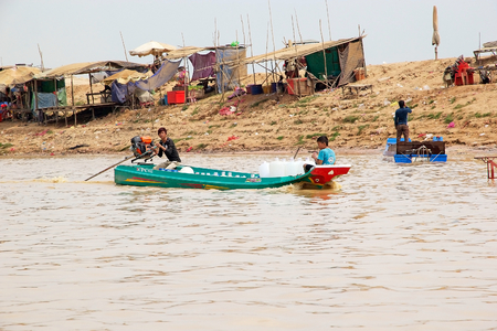 tonle sap: Inhabitants on the Tonle sap lake, Cambodia. Tonle Sap is a combined lake and river system of major importance to Cambodia and it is the largest freshwater lake in the Southeast Asia