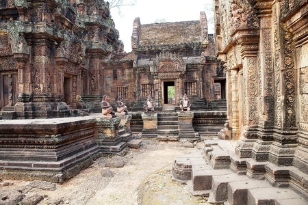 hindu god shiva: The central complex with the stairs guardians at the Banteay Srei temple, located in the area of Angkor,Siem Reap, Cambodia. Banteay Srei temple is a 10th century temple dedicated to the Hindu God Shiva. It is built largely of red sandstone with elaborate