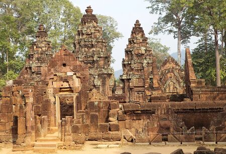 hindu god shiva: Banteay Srei temple ruins, located in the area of Angkor,Siem Reap, Cambodia. Banteay Srei temple is a 10th century temple dedicated to the Hindu God Shiva. It is built largely of red sandstone with elaborate decorative wall carving.