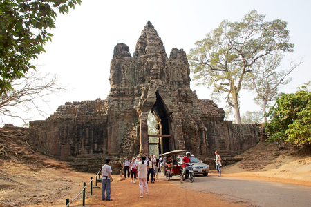 angkor thom: Tourists are getting in Angkor Thom from the South gate, Siem Reap, Cambodia. Angkor Thom was the lsat and most enduring capital of Khmer Empire and covers an area of 9 Kmsq within which are located several monuments Editorial