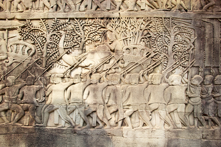 historical events: Reliefs at the Bayon, Angkor, Siem Reap, Cambodia. The outer walls of the outer gallery features a series of reliefs depicting historical events and scenes from the everyday life of the Angkorian Khmer. This is a scene from the eastern gallery and show th