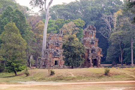 spanned: Two of the Prasat Suor Prat, Angkor, Siem Reap, Cambodia. Prasat Suor Prat is a series of towers twelwe spanned from north to south lining the eastern side of Royal square in Angkor Thom. The tower are made for laterite and sandstone.